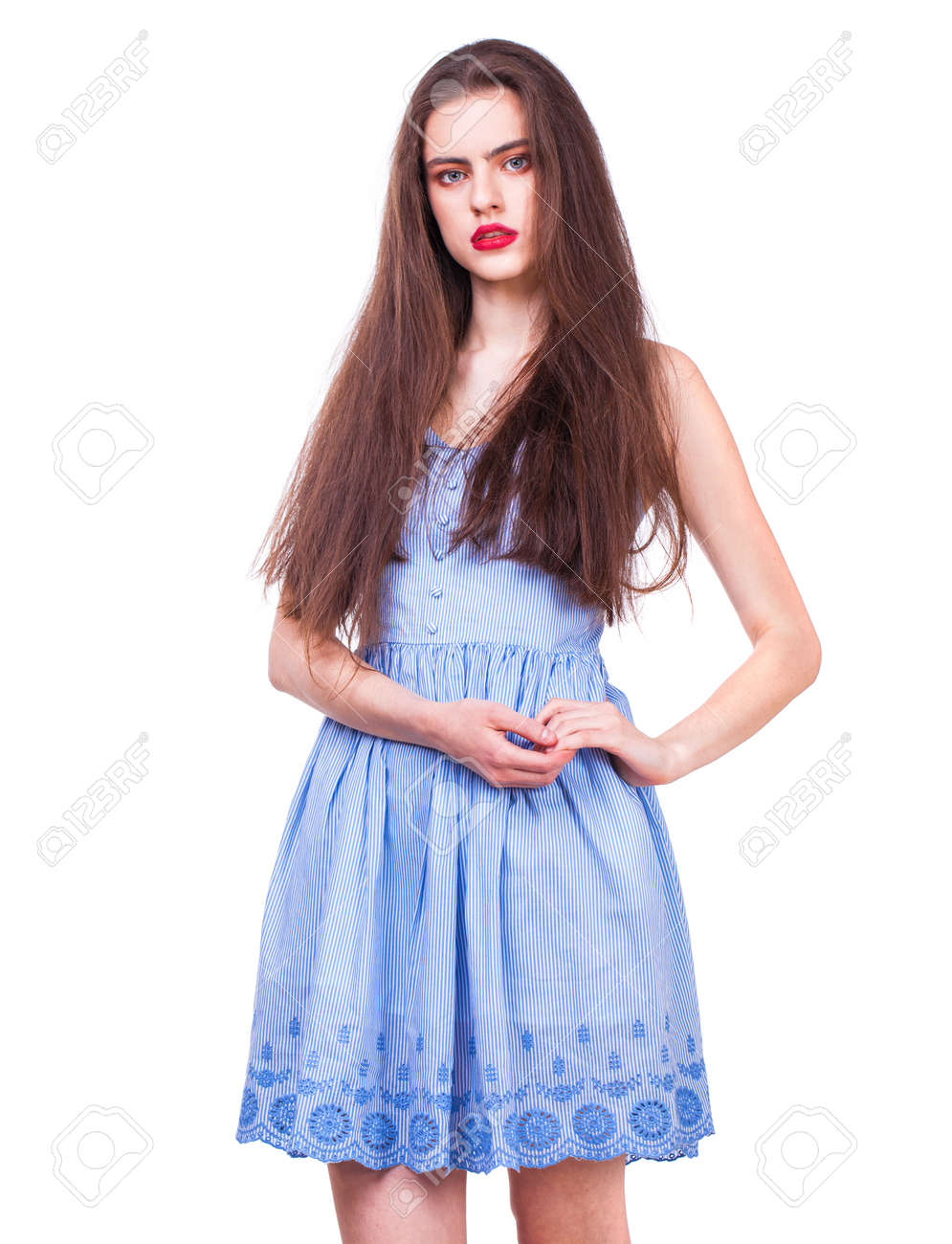 Close up portrait of a young beautiful happy brunette woman in blue dress, isolated on white background - 147518993