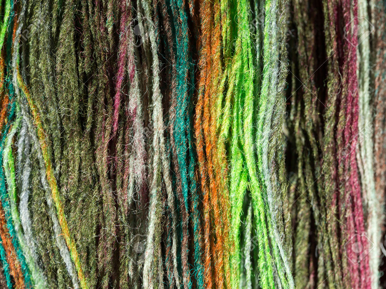 Yarn from natural natural material in various colors - 168930461
