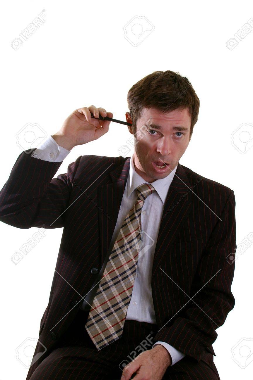 Bored man boring a hole through his brain with a pen Stock Photo - 4867371