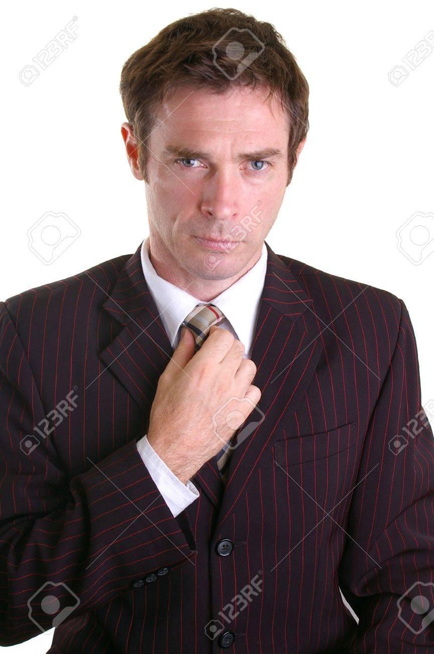 smart dressed business man adjsuting his tie Stock Photo - 5002197