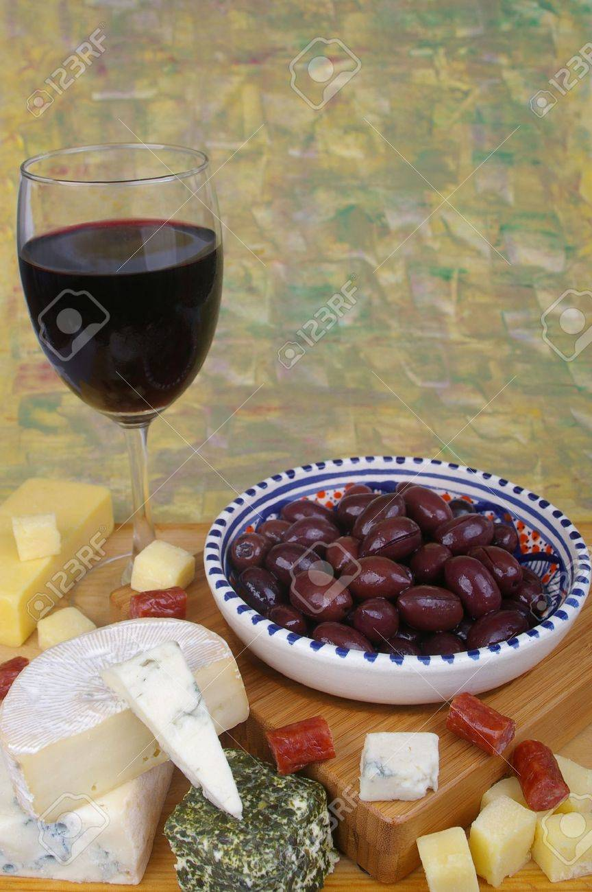 cheese antipasto varieties with olives and wine Stock Photo - 7549145