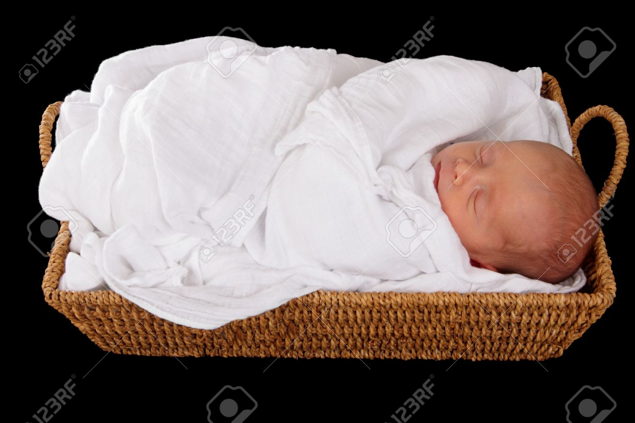 baby in wicker moses basket isolated over black Stock Photo - 9668095