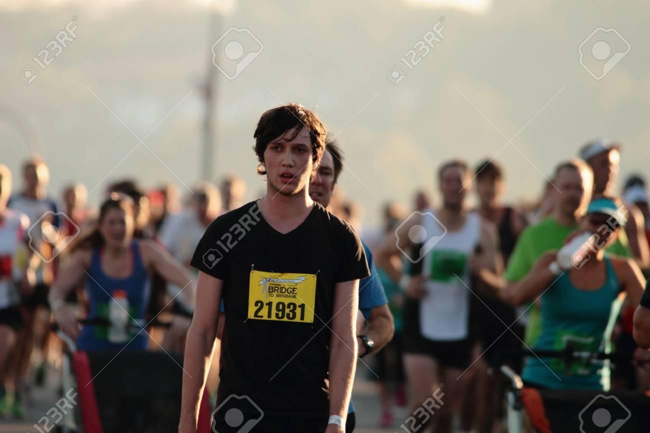 "BRISBANE, AUSTRALIA - SEPTEMBER 02 : Unidentified runners participating in the ""Bridge to Brisbane"" charity fun run on September 02, 2012 in Brisbane, Australia - 15269699"