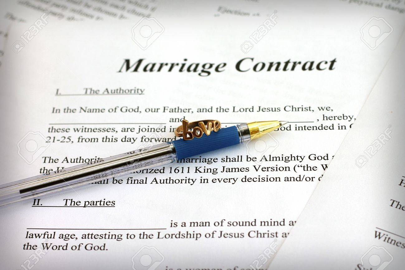 Marriage contract with pen and ring close up stock photo picture marriage contract with pen and ring close up stock photo 17743775 altavistaventures Choice Image