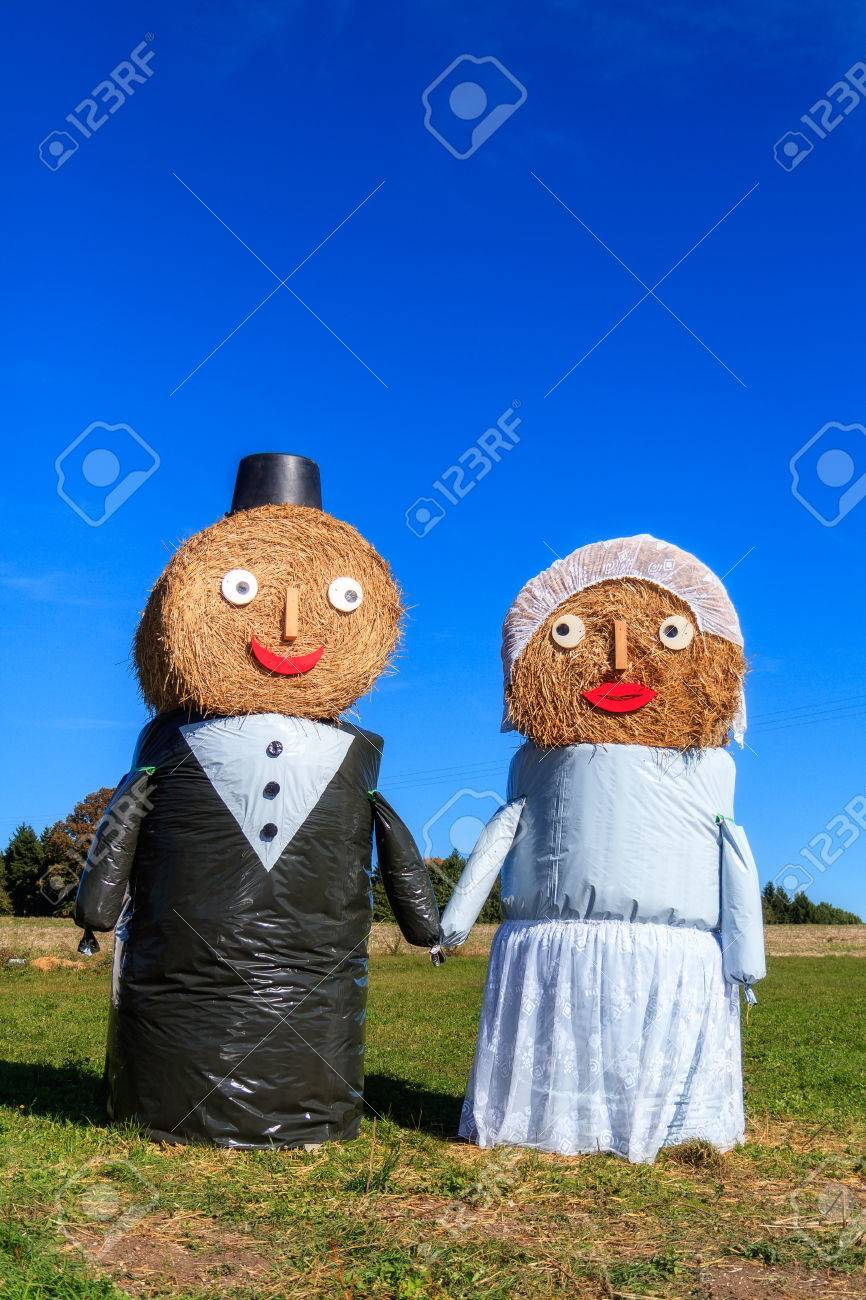 Marriage Tradition in Bavaria  Lovely Bridal Couple Puppets made out of Hay Bale with Suit and Wedding Dress in Europe in Autumn Stock Photo - 22737336