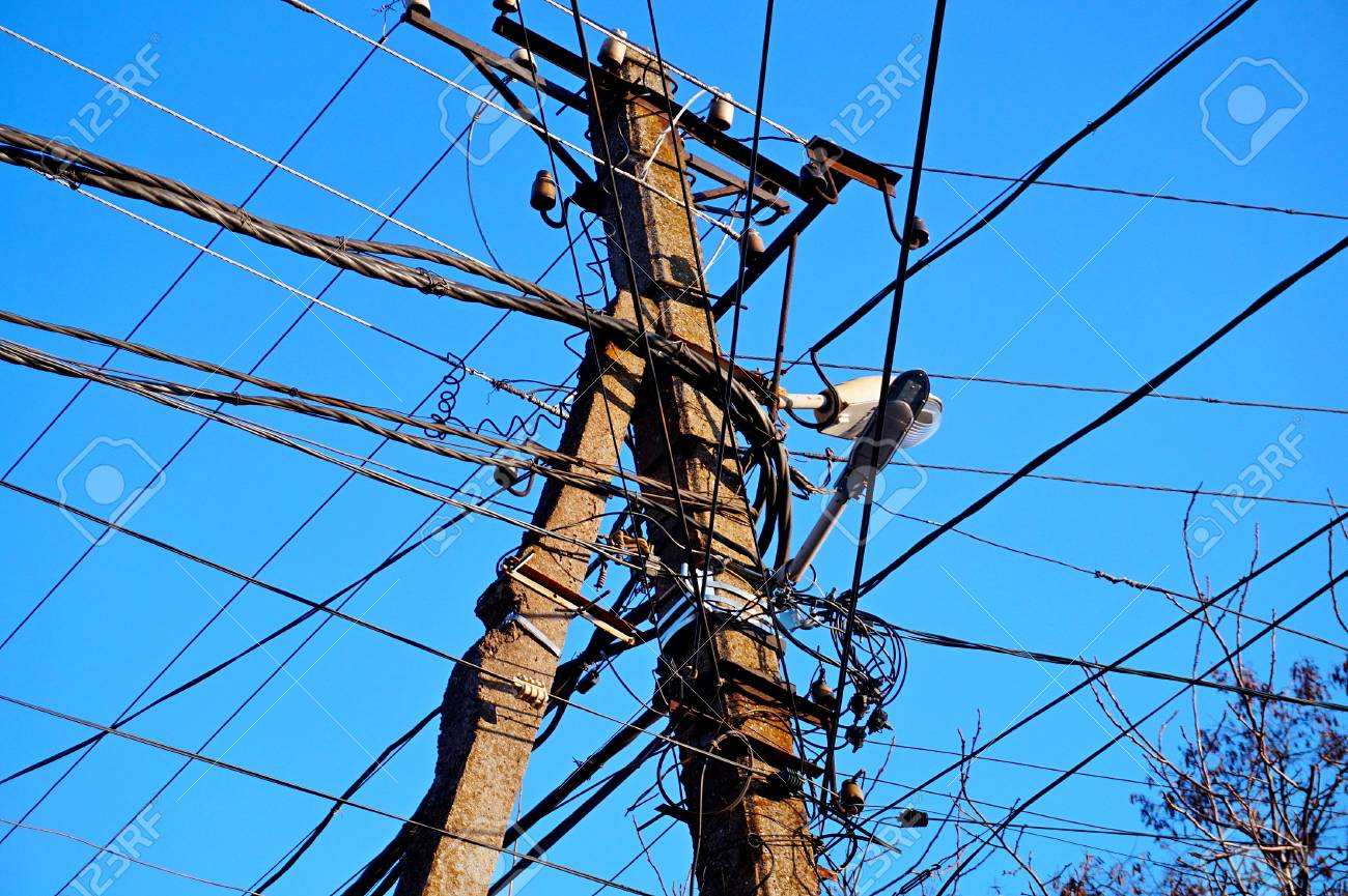 Wooden Electric Pole With Wires On The Street In The City Against ...