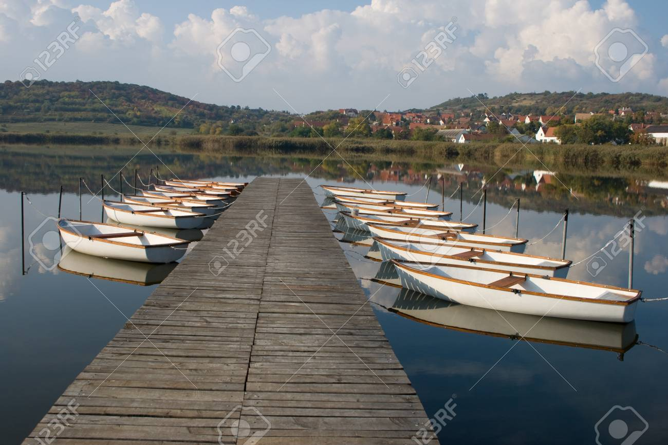 Lots of white angler boats at a boat jetty. Stock Photo - 17617970
