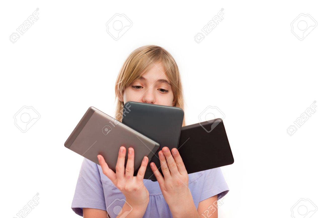 ebook readers and tablets young girl holding different types
