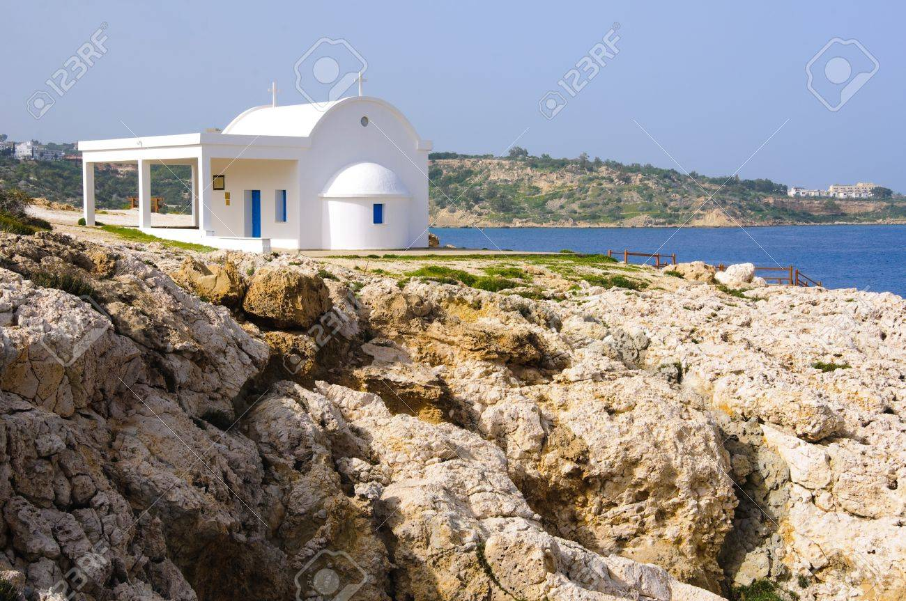 Small white-and-blue church by the sea Stock Photo - 9177508