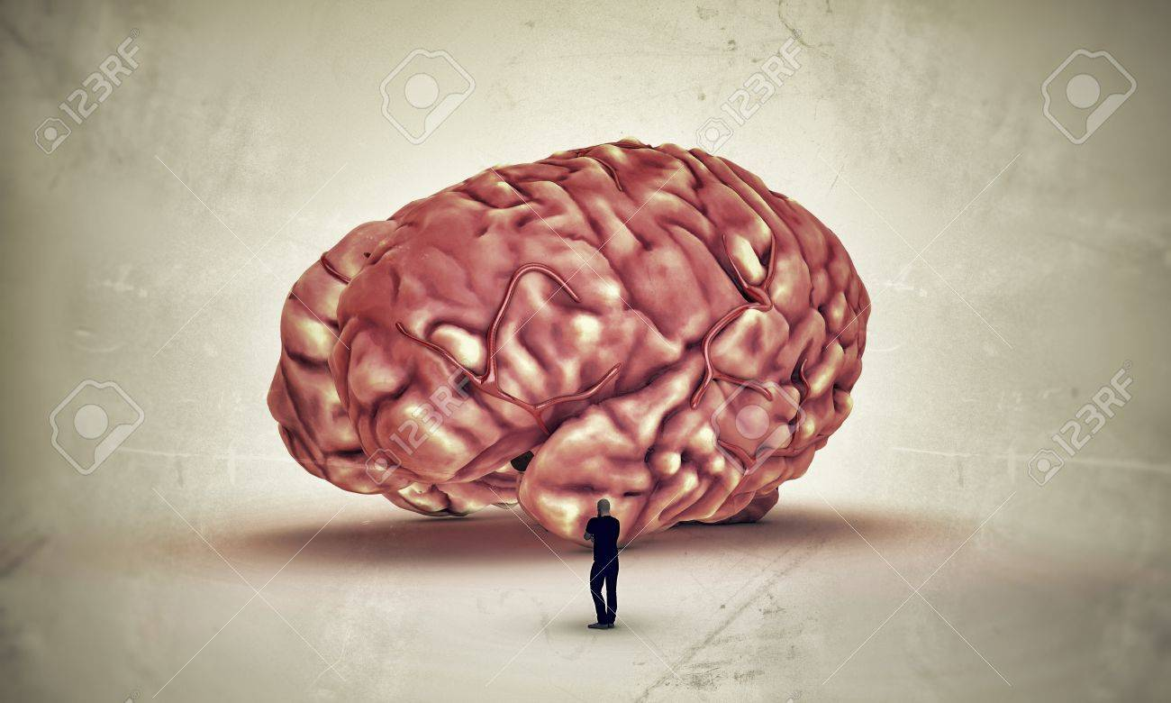 Man In Black Thinking With A Big Brain Drop On The Floor Stock Photo