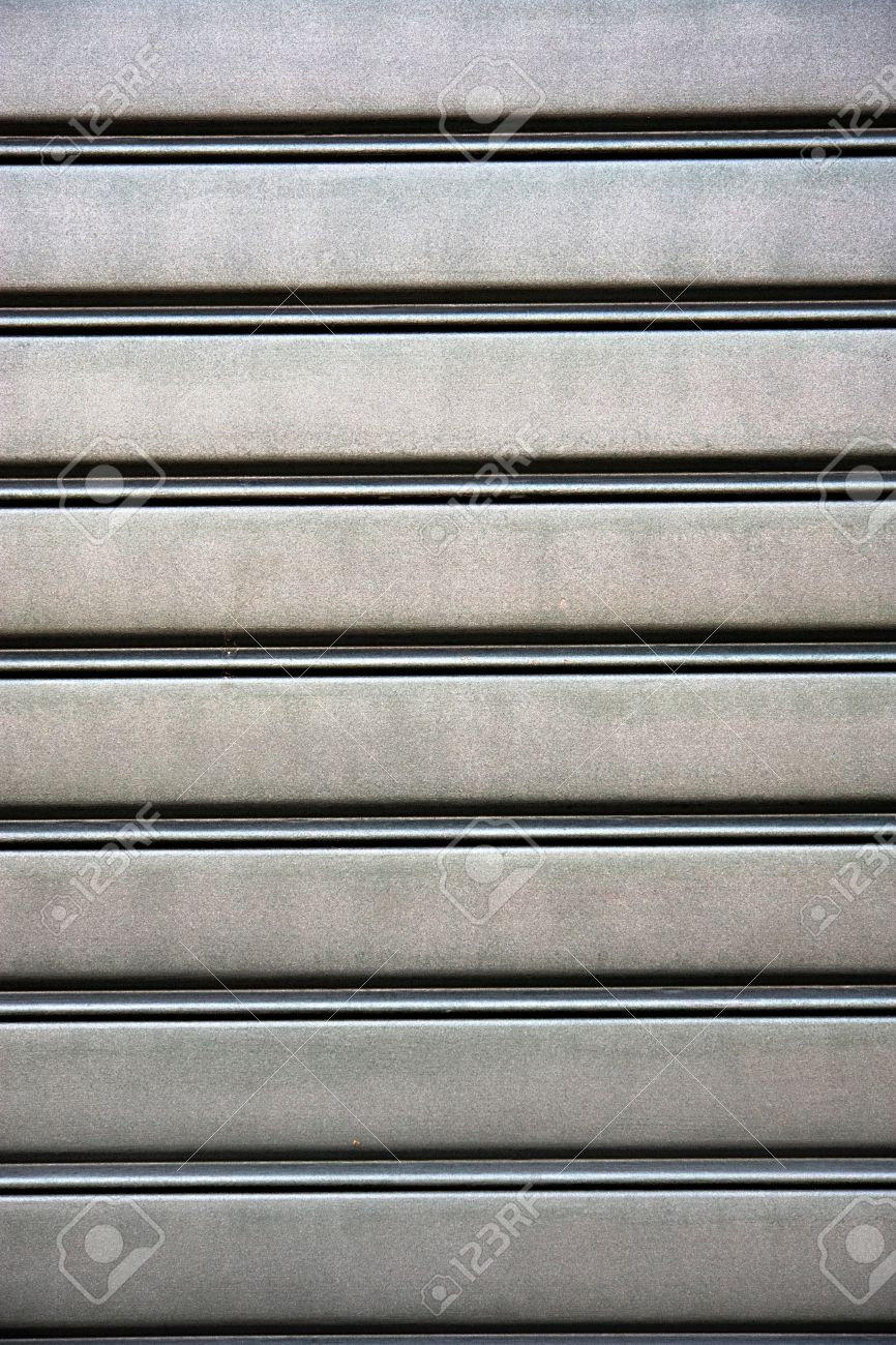 background texture of a plain smooth silver metal panel with a pattern of parallel ridges and