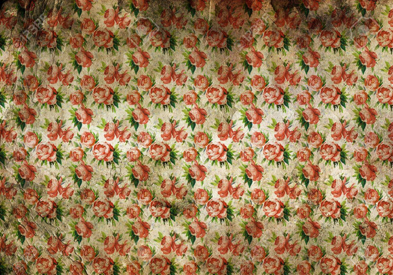 Background Texture Of Stained Vintage Floral Wallpaper With Discoloured Patches And A Busy Repeat Pattern