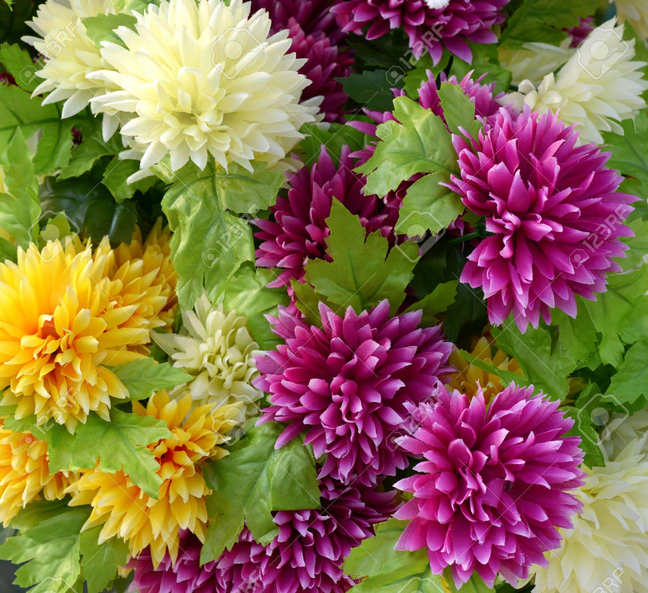 Close Up Bouquet Of Attractive Fake Yellow And Magenta Plastic