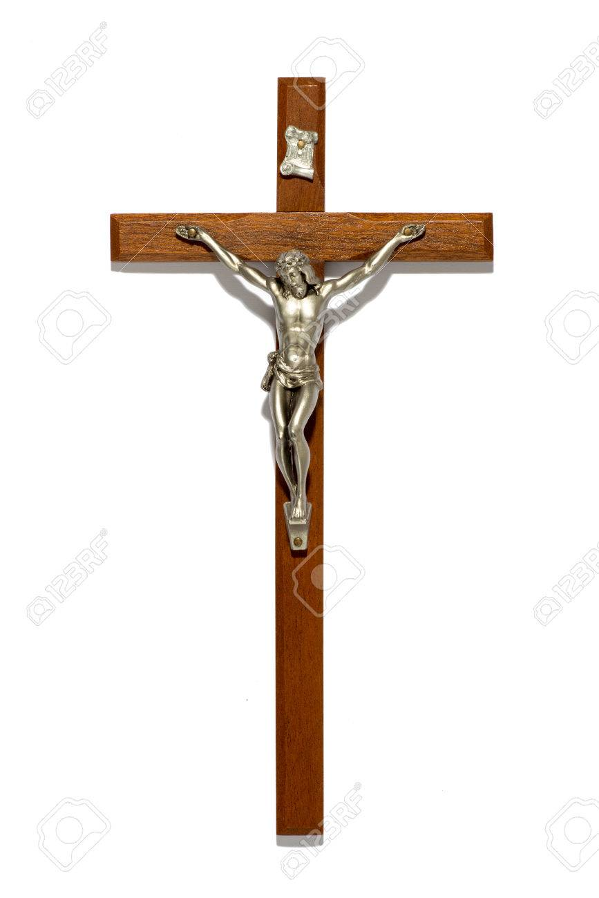 Plain wooden crucifix with silver figure of Christ, a religious