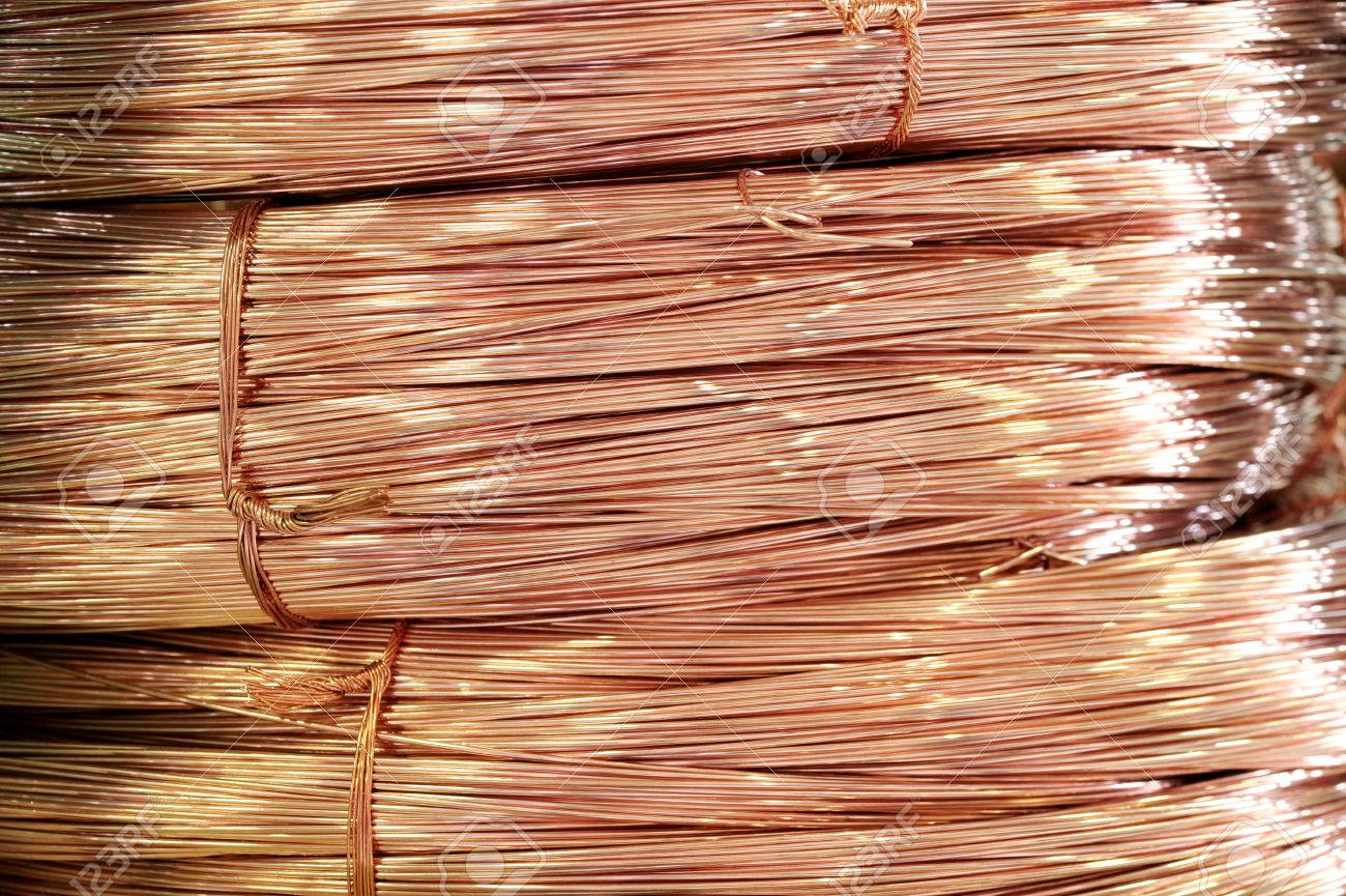 Close Up On Coils Of Shiny Copper Wire Stored As A Raw Metal ...