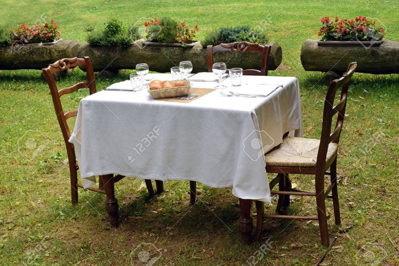 Stock Photo - Wooden tablecloth set with a formal table setting and two chairs for al fresco dining on a private lawn in summer sunshine & Wooden Tablecloth Set With A Formal Table Setting And Two Chairs ...