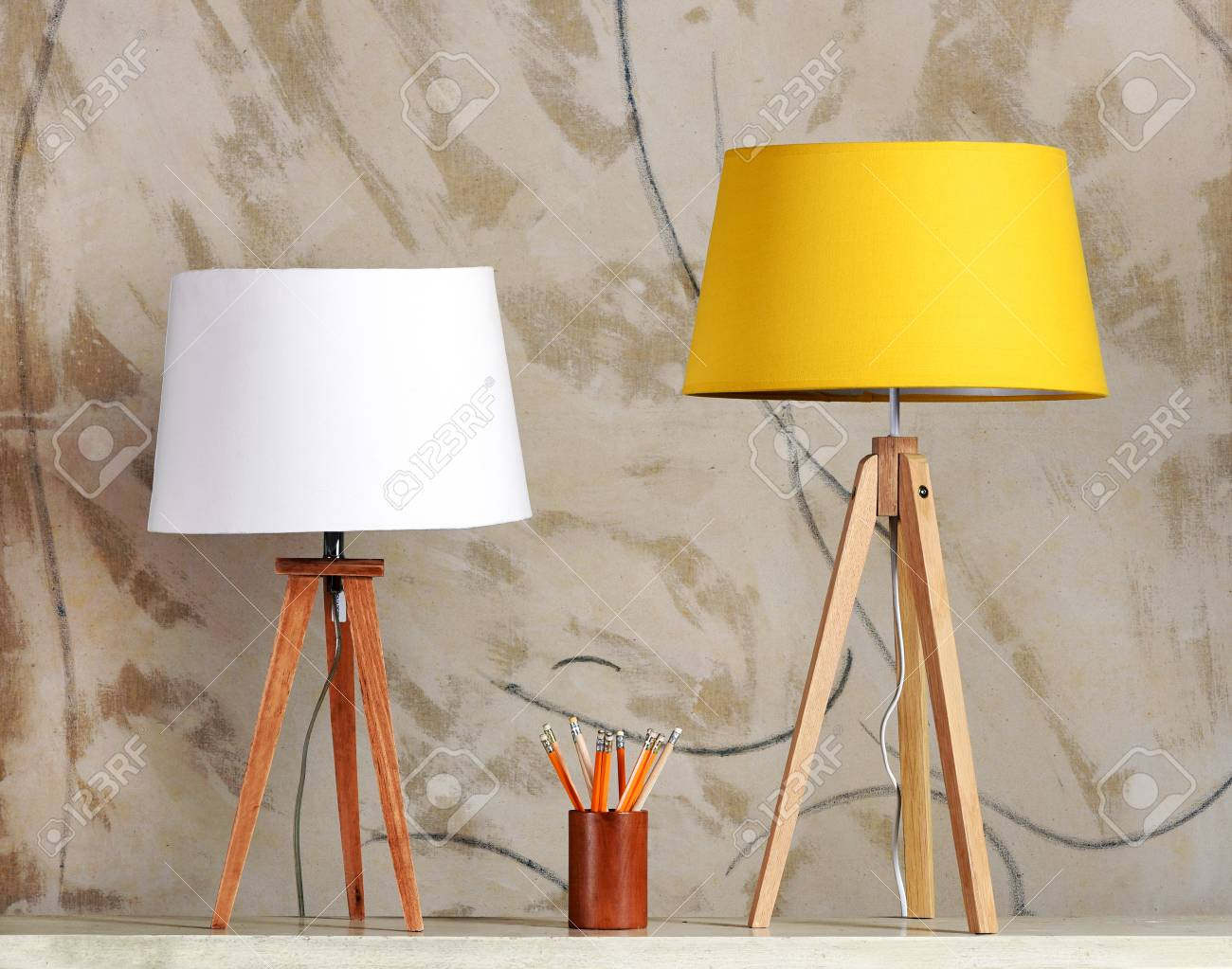 Still Life Of Two Table Lamps With White And Yellow Shades On