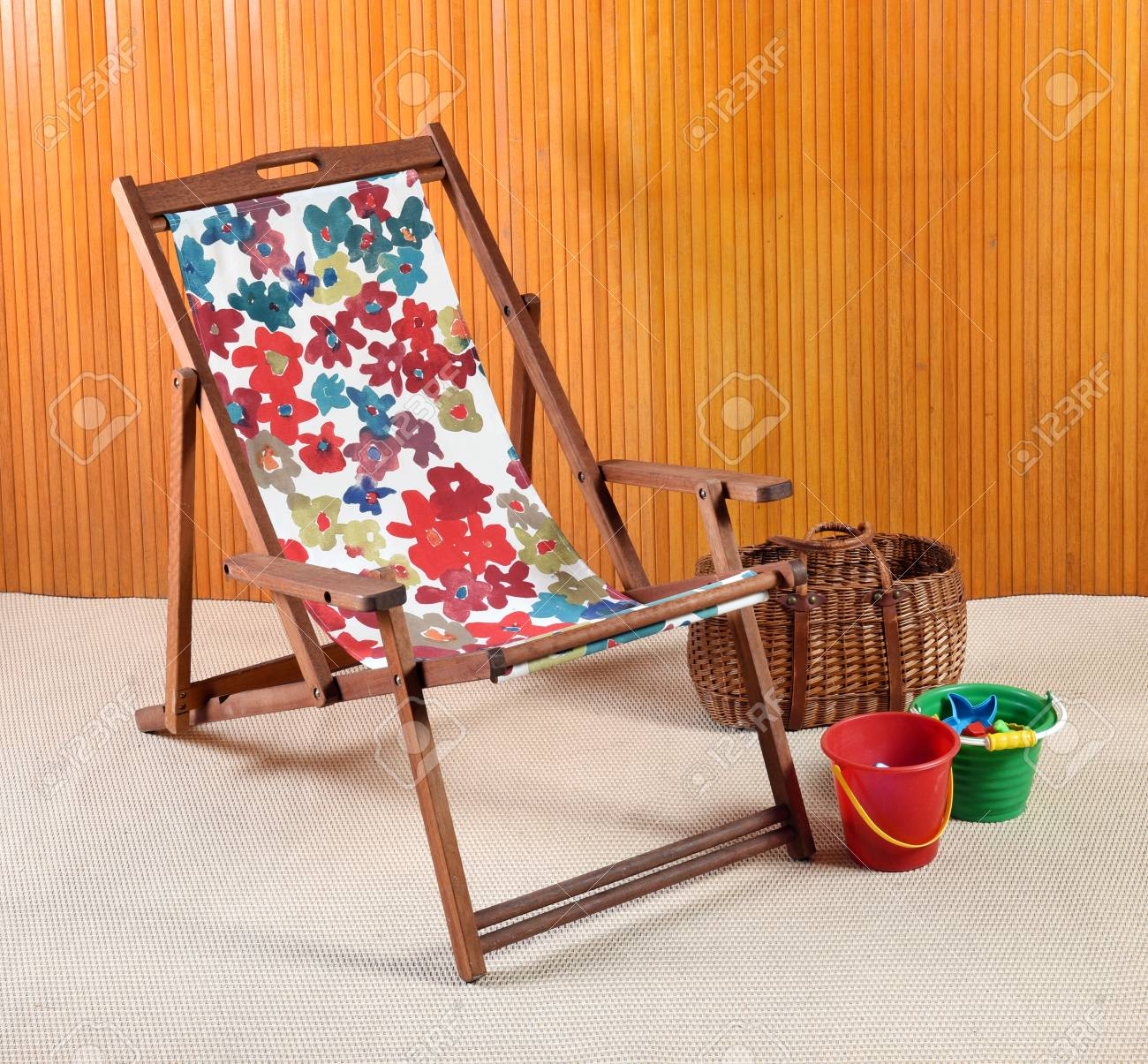 Delicieux Stock Photo   Wooden Canvas Folding Beach Or Deck Chair With Colorful Floral  Print Textile Alongside Plastic Kids Buckets And A Wicker Basket