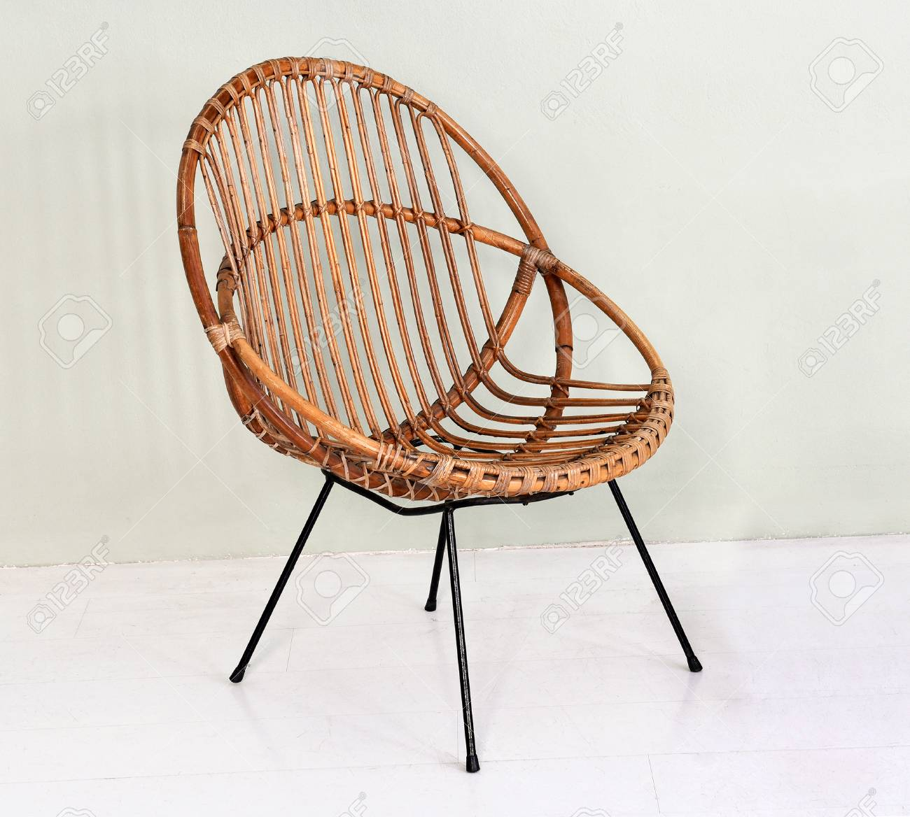 Comfortable Round Wicker Chair With Metal Legs Made With Intertwined