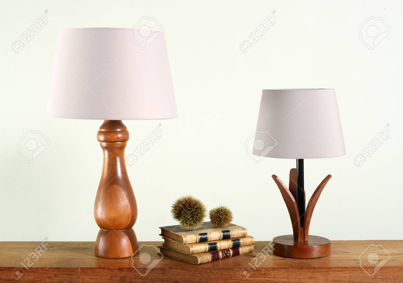 Decorative Wooden Table Lamps With White Shades Close Up On Shelf