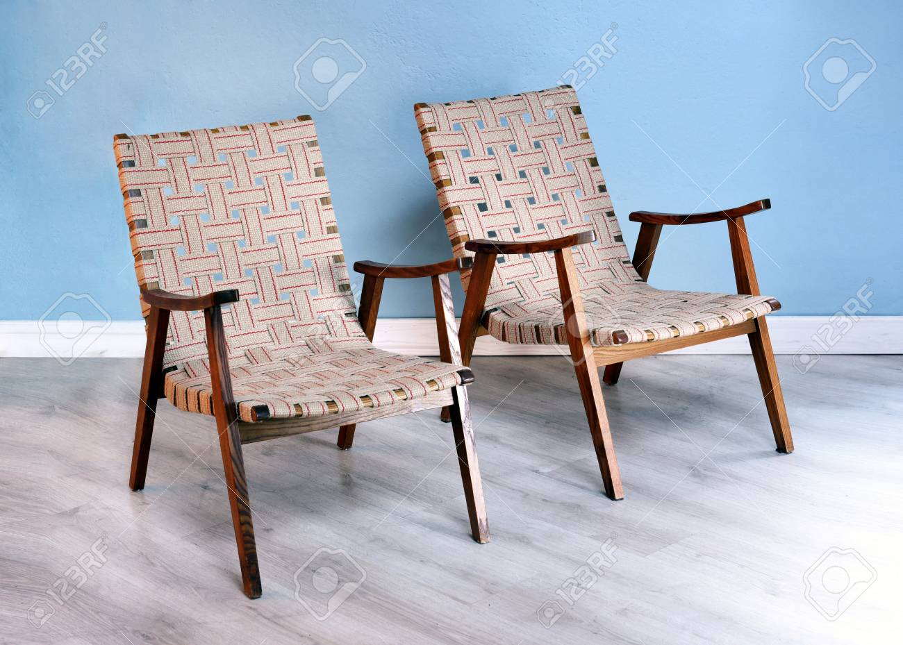 Two Comfortable Wooden Easy Chairs With Woven Strap Upholstery