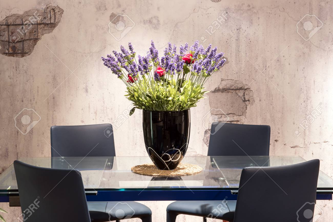 Dining Table With Floral Centerpiece With Colorful Blue And Red Stock Photo Picture And Royalty Free Image Image 110072375