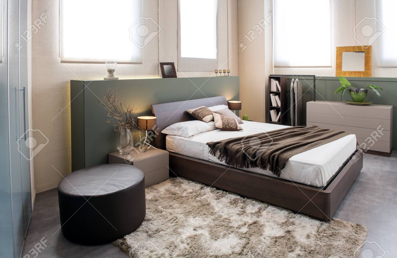 Picture of: Modern Luxury Brown Monochrome Bedroom Interior With Large Headboard Stock Photo Picture And Royalty Free Image Image 126576408