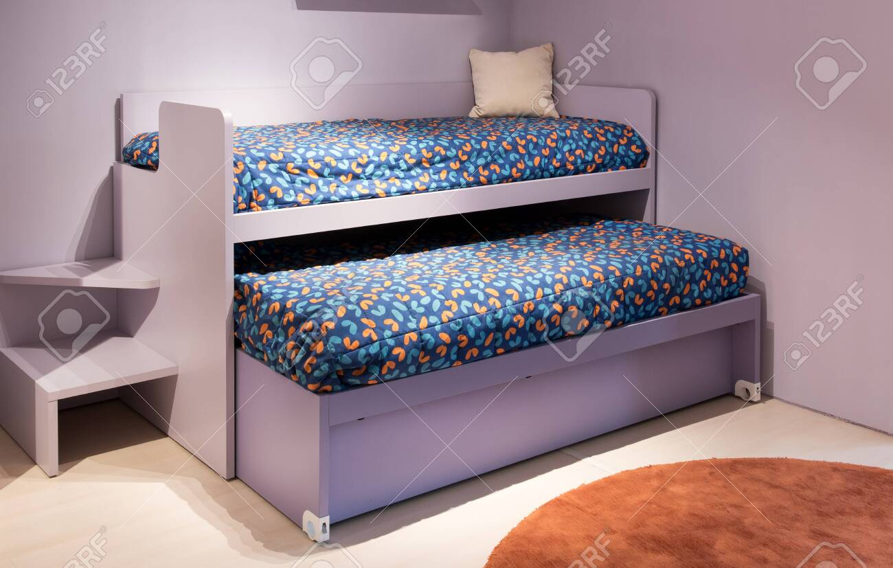 Picture of: Double Bunk Bed In A Kids Bedroom With Purple Decor And Colorful Stock Photo Picture And Royalty Free Image Image 129305143