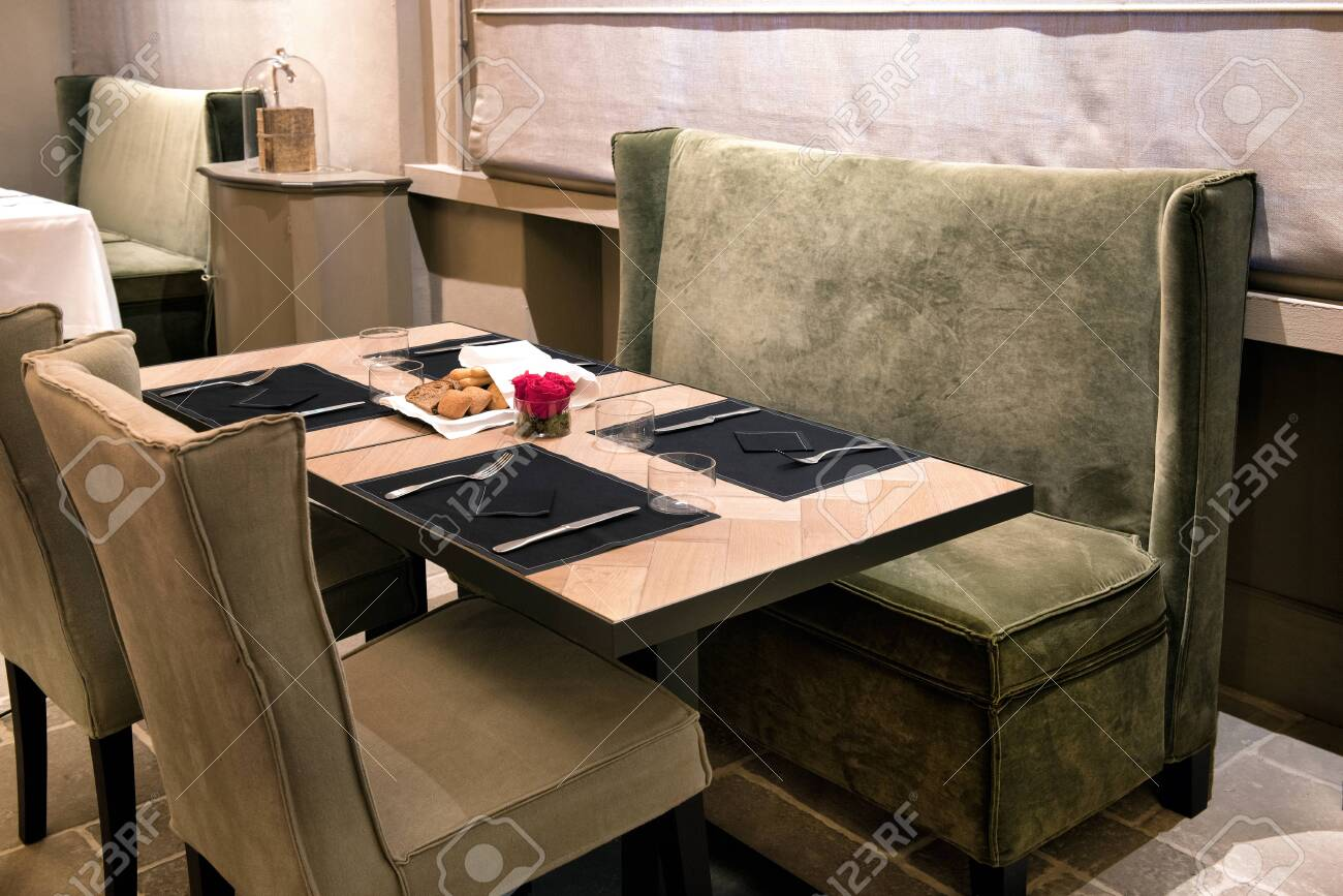 Elegant Restaurant Table With Green Plush Covered Seating And Stock Photo Picture And Royalty Free Image Image 142270504