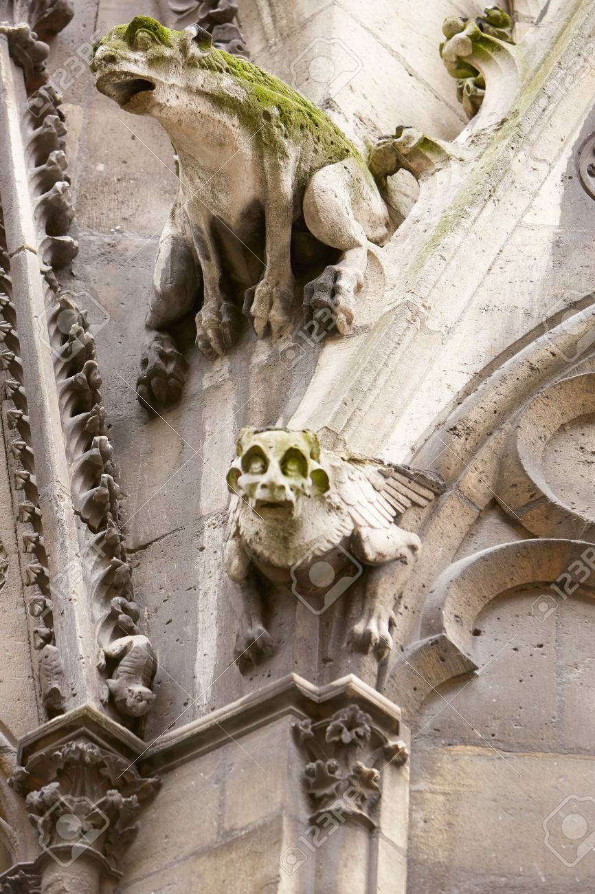 Paris Notre Dame Gargoyles Statues On The Gothic Cathedral Stock Photo