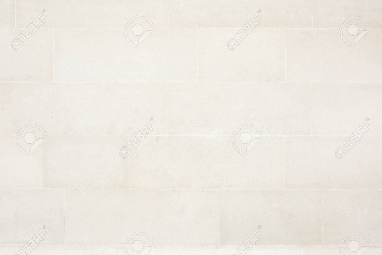 Beige tiled stone wall texture background stock photo picture and