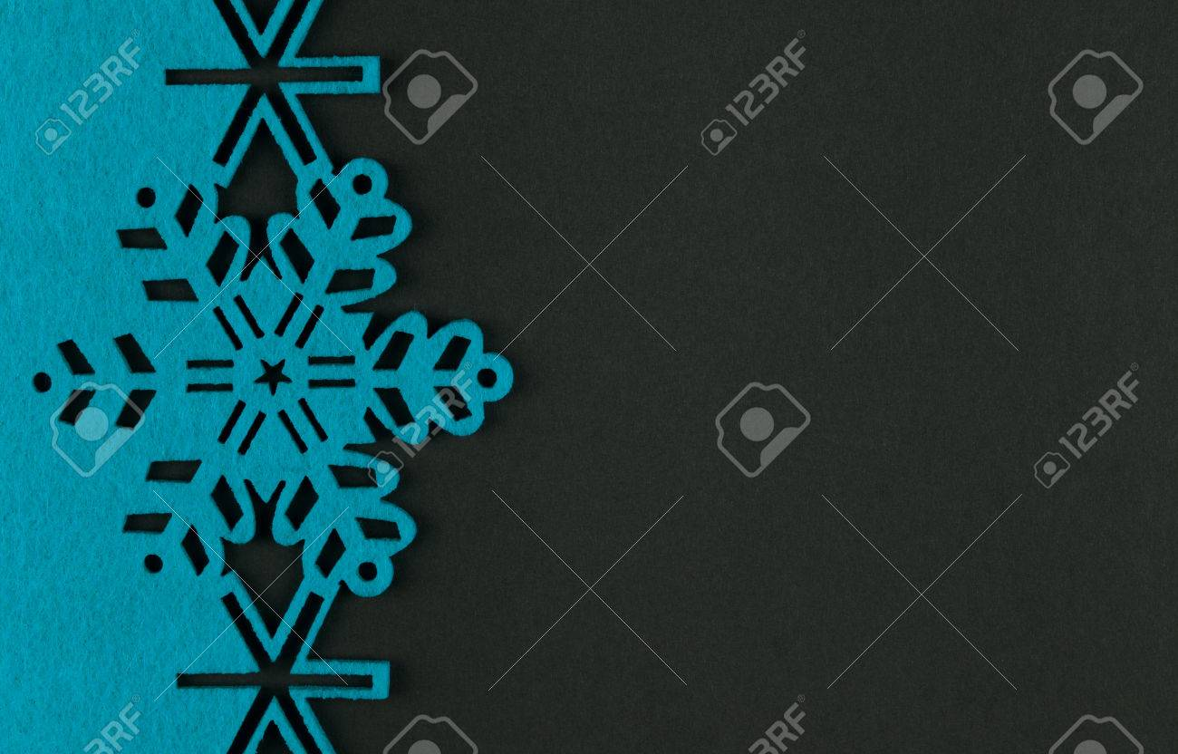 Unusual design christmas background with blue snowflakes and copy space on dark grey background - 33722745