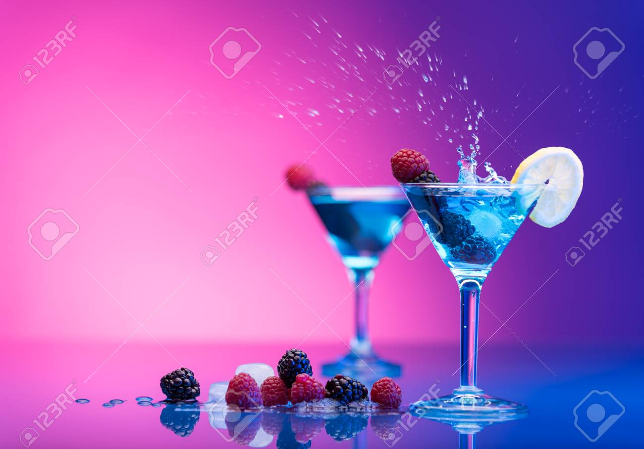 Colourful cocktails garnished with berries - 37493419