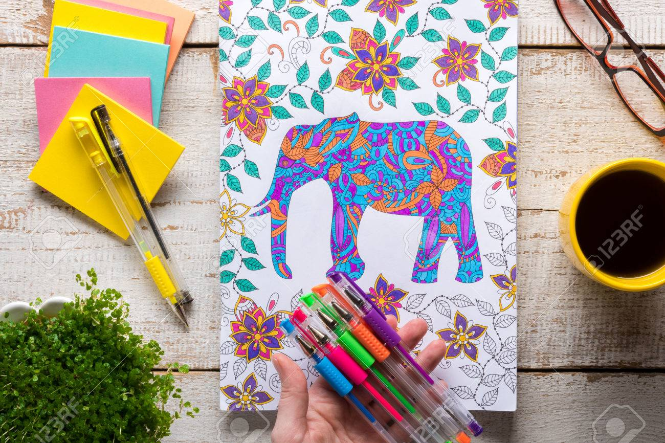 Woman Holding Gel Pens, Adult Coloring Books, New Stress Relieving ...