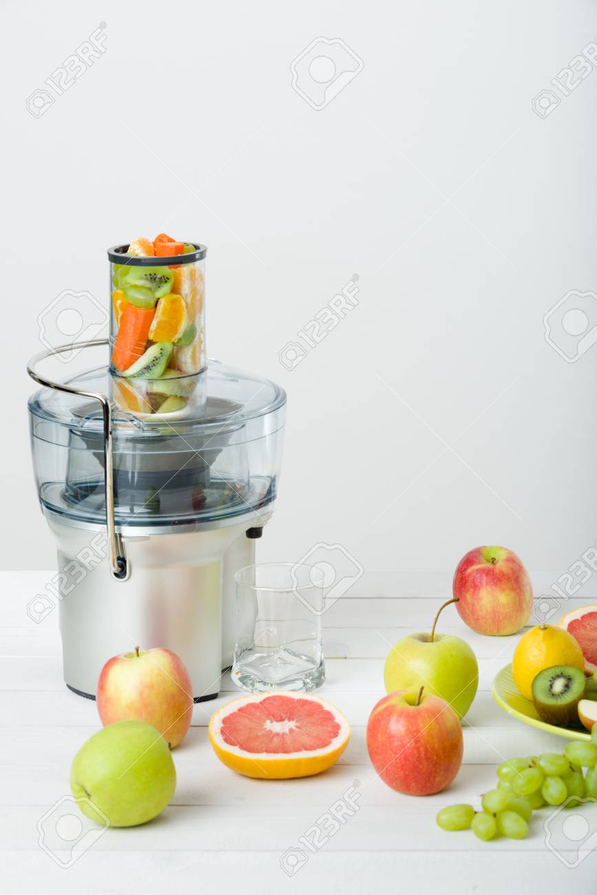 Modern electric juicer and various fruit on kitchen counter, healthy lifestyle concept Stock Photo - 73482181