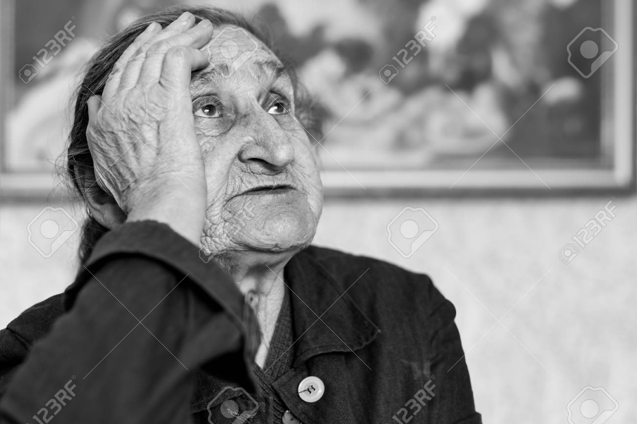 Beautiful 80 plus year old senior woman portrait black and white image of elderly worried