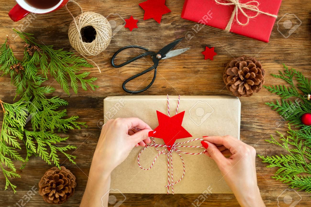 Christmas Gift Wrapping Station.Diy Gift Wrapping Woman Wrapping Beautiful Red Christmas Gifts