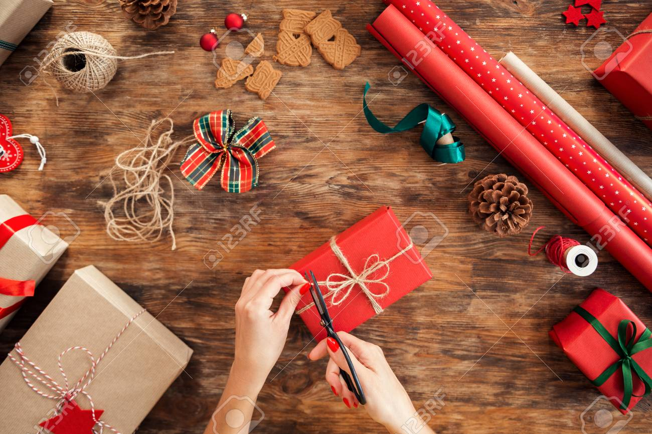 DIY Gift Wrapping. Woman Wrapping Beautiful Red Christmas Gifts ...