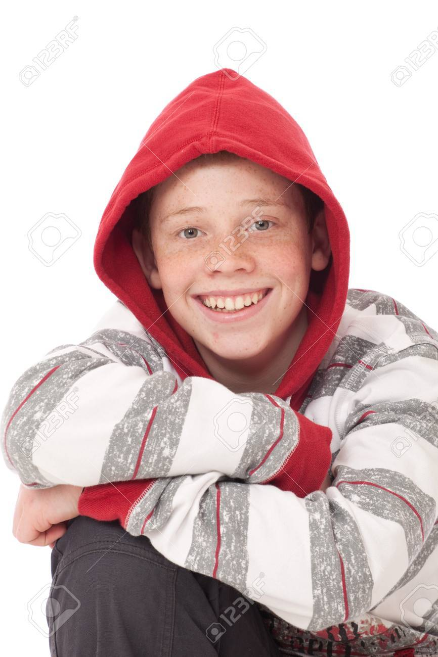 Young teenage boy kneeling with crossed arms and red hood Stock Photo - 9427093