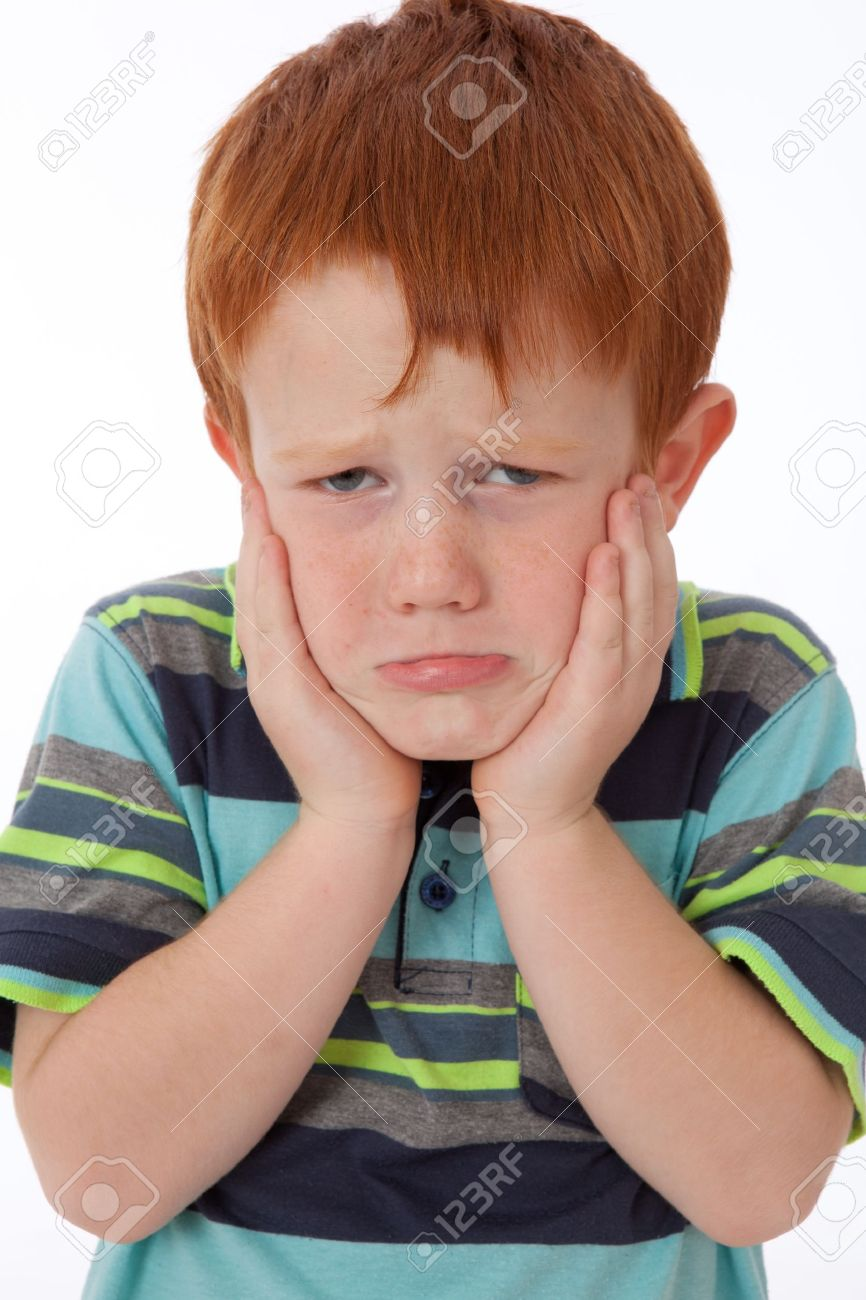Young red head boy holding face and looking sad and despondant Stock Photo - 9620609