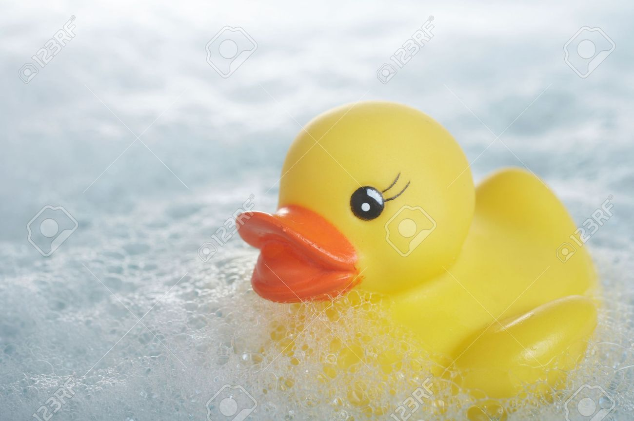 Yellow Rubber Duck Floating In Suds In Bathtub Stock Photo, Picture ...