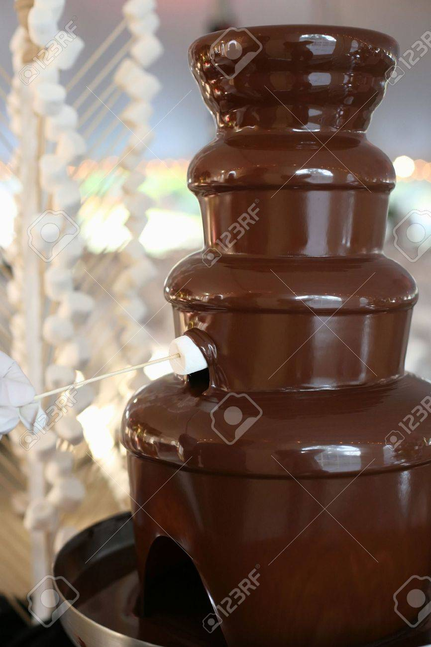 Chocolate Fondue Fountain With Marshmallow Being Dipped Stock ...