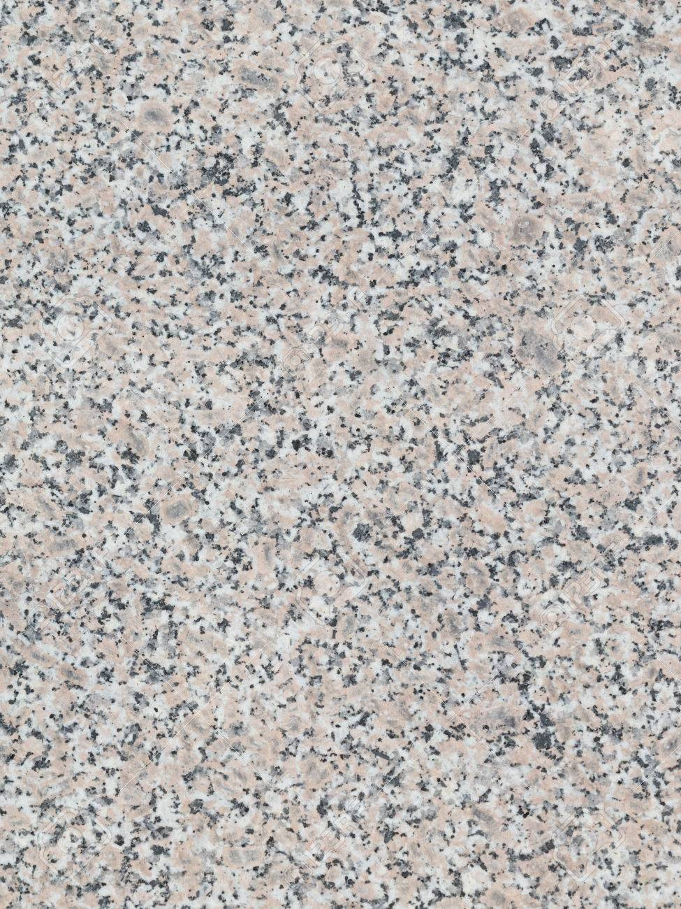 texture of gray granite stone with small patches in the slab