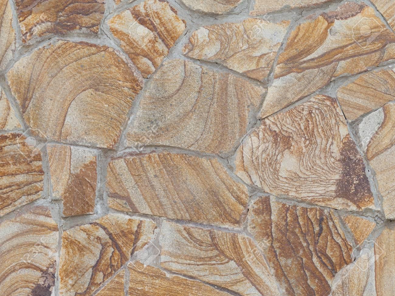 Dekorative Braune Wand Aus Naturstein Mit Schönen Bunten Flecken Und Ort  Standard Bild   38446629