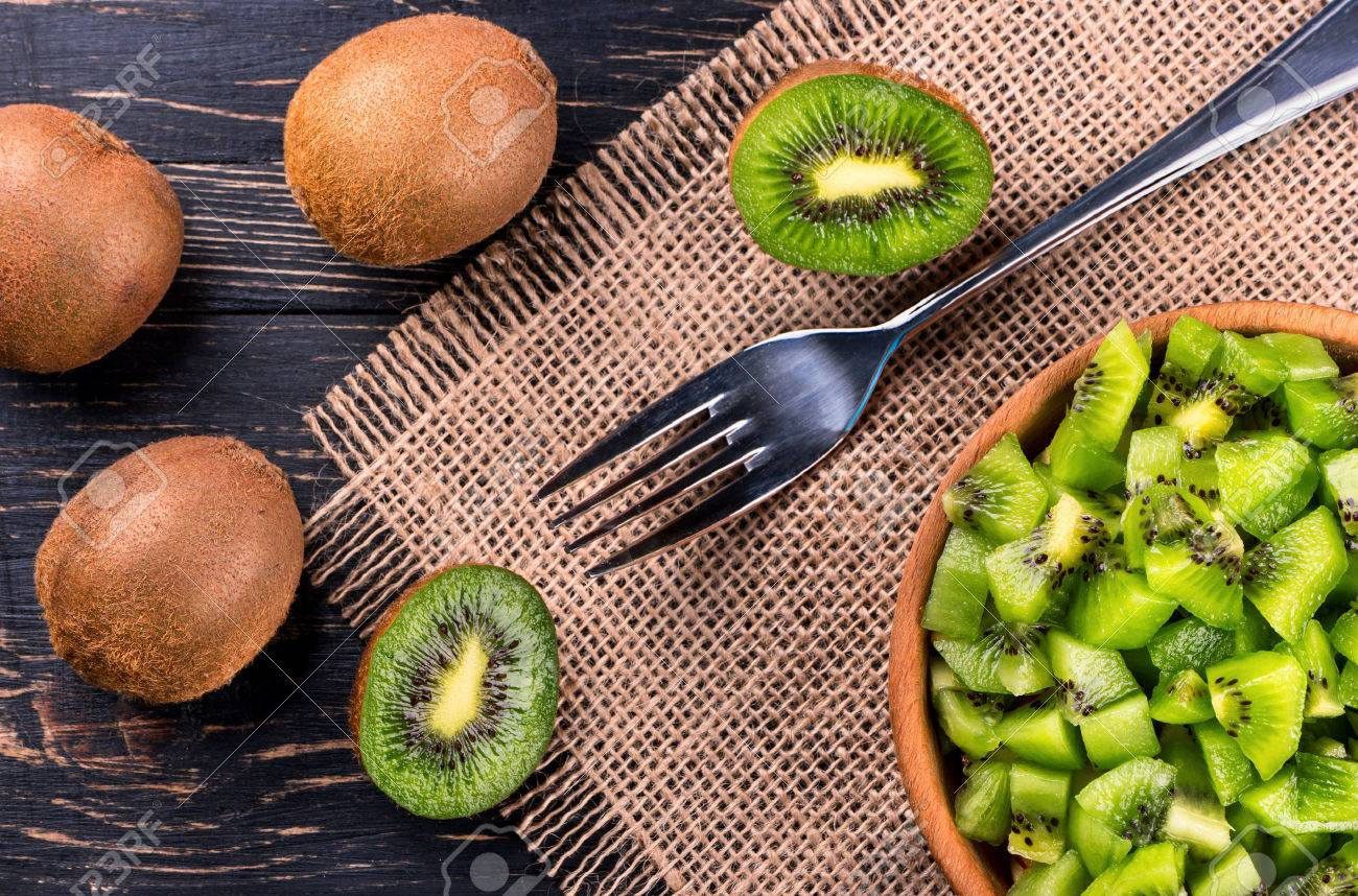 Image result for kiwi on wooden table
