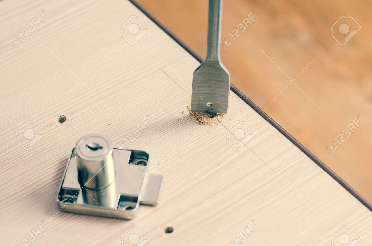 Drilling Holes In A Wooden Block Stock Photo Picture And Royalty
