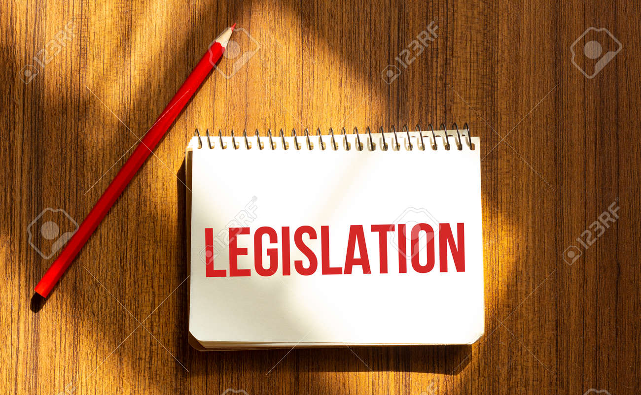 Red pen and notepad with text LEGISLATION in the white background - 157526484