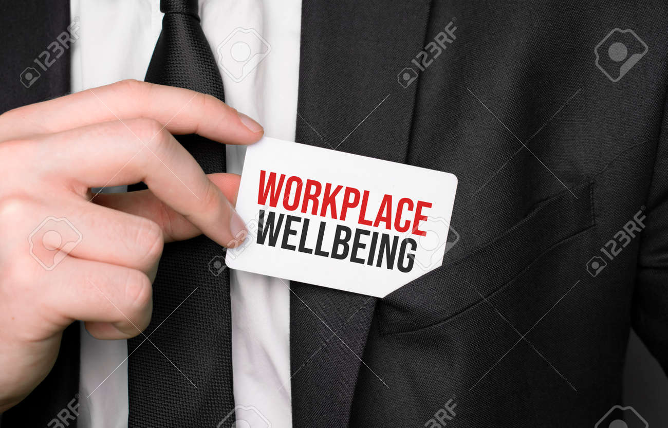 Businessman holding a card with text Workplace Wellbeing - 173913462