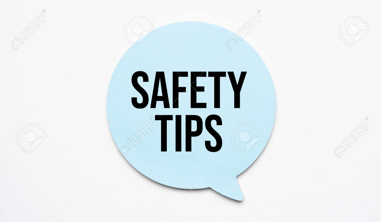 Safety tips speech bubble and black magnifier isolated on the yellow background. - 173913504