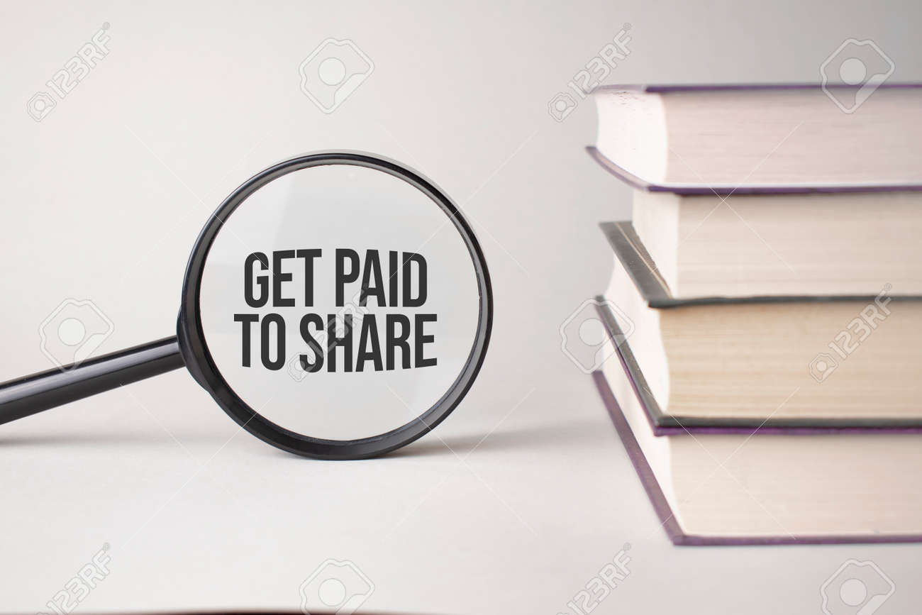 The inscription Get Paid To Share is written and the books. Content lettering is essential for business content and marketing. - 173913552
